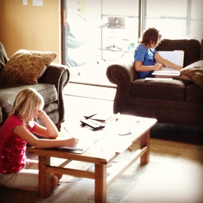 Girls schooling in living room Copyright by Holly Hedman